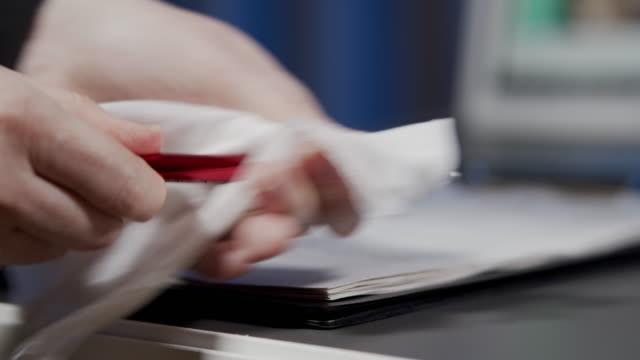 wiping a pen - penna video stock e b–roll