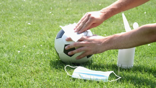 wiping a soccer ball clean. - only young men stock videos & royalty-free footage