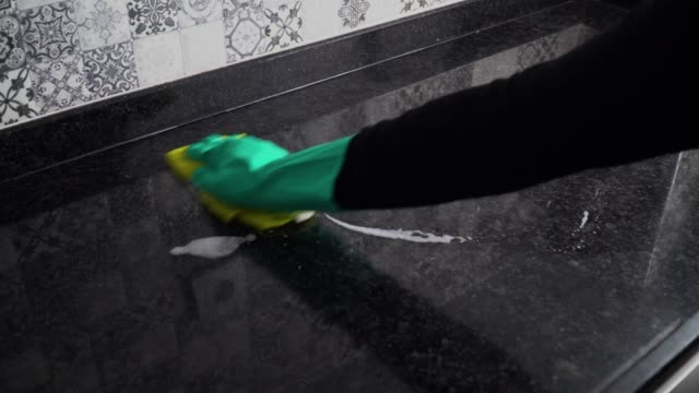 wiping down surfaces for covid-19 or coronavirus - dishcloth stock videos & royalty-free footage