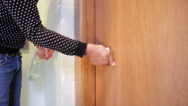 wiping the door handle - safety stock videos & royalty-free footage