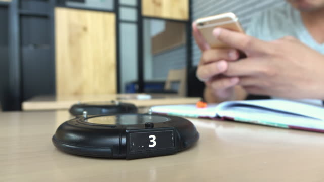 wireless paging system, alarm for pickup food in cafe - setting alarm stock videos and b-roll footage