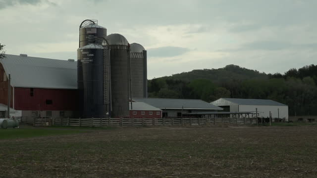 wisconsin dairy farm and grain silos - wisconsin video stock e b–roll