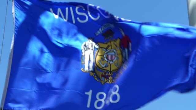 wisconsin state flag waving in the breeze - wisconsin video stock e b–roll