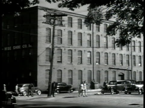 wise shoe co.' factory building workers leaving. int shoemakers working machines. young man pushing cart of shoes workers bg. new hampshire. - exeter england stock videos & royalty-free footage