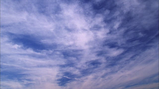 wispy cirrus clouds in blue sky move overhead available in hd. - wispy stock videos and b-roll footage