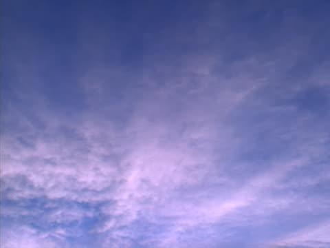wispy cloud cover from day to dusk - sky only stock videos & royalty-free footage