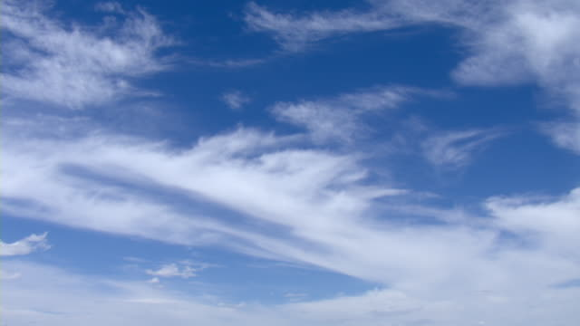 Wispy clouds drift across the sky.