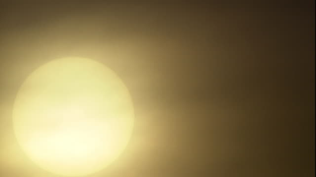 wispy clouds float in front of the sun. - wispy stock videos & royalty-free footage