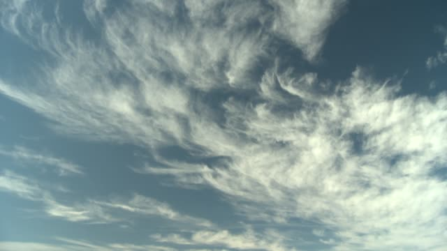 wispy clouds quickly drift through the blue sky. available in hd. - wispy stock videos and b-roll footage