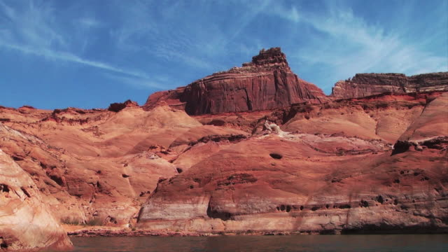 wispy clouds streak through the sky over red rock formations. - wispy stock videos and b-roll footage