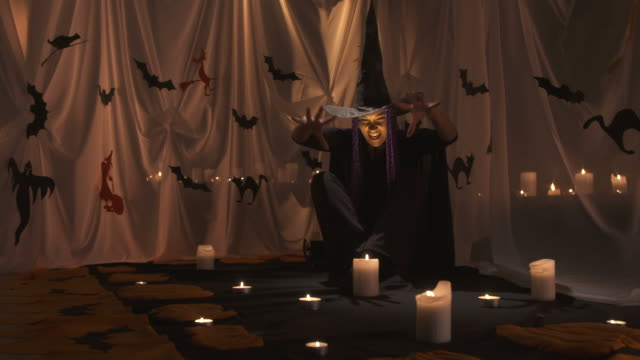 hd: witch conjuring a spell - demon fictional character stock videos & royalty-free footage