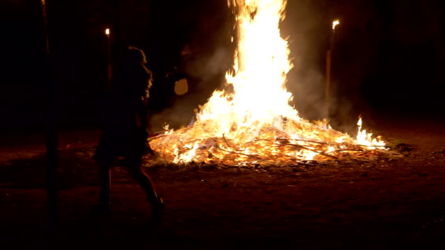 witches dancing near a bonfire during 'giubiana' a traditional celebration in the northern italy where a puppet of an old witch is burnt 30 january... - devil stock videos & royalty-free footage