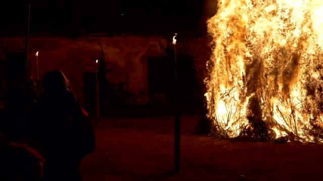 witches dancing near a bonfire during 'giubiana'- a traditional celebration in the northern italy where a puppet of an old witch is burnt - 30... - witch stock videos & royalty-free footage