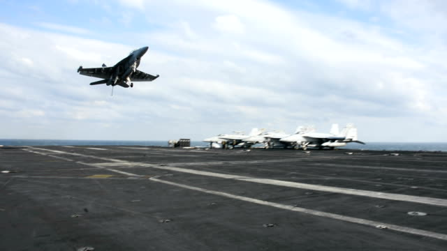 with a deafening roar, fa-18 fighter jets and other aircraft performed touch-and-go landing operations on the uss nimitz aircraft carrier on november... - air vehicle stock videos & royalty-free footage
