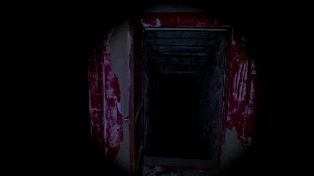 with a flashlight in the ruined house at night