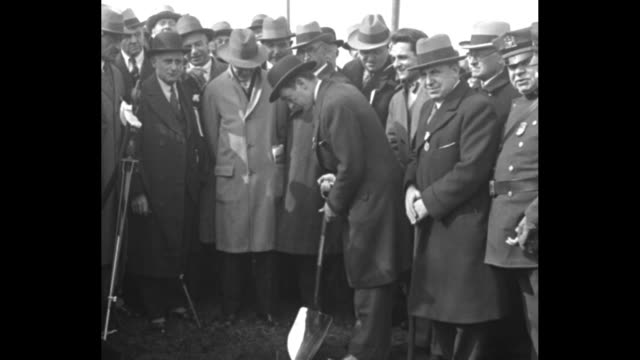 with a group of men looking on, new york mayor jimmy walker breaks ground for the triborough bridge with a shiny shovel; he jokes, all laugh; then he... - 1920 1929 stock videos & royalty-free footage