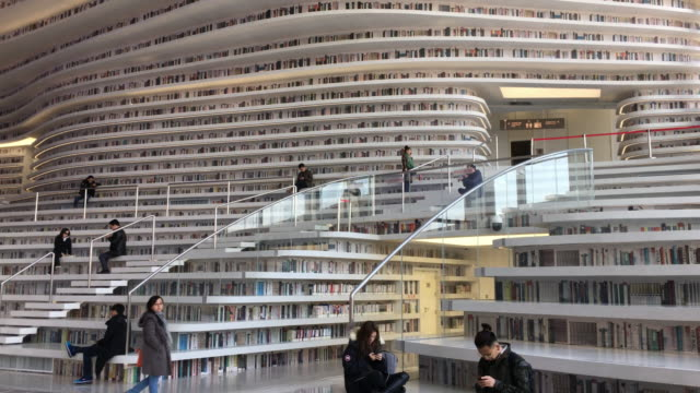 with a huge spherical multifunction hall and circle steps to the ceiling tianjin binhai new area library is now a popular topic on social media and a... - library stock videos & royalty-free footage