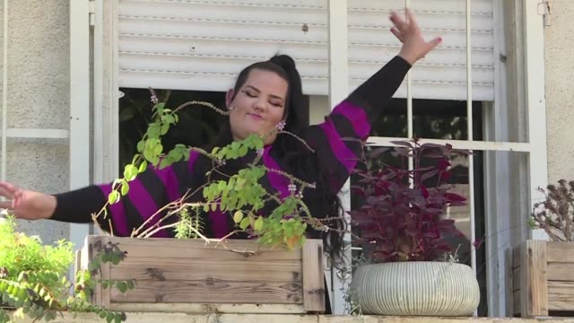 with a multicoloured kimono, clucking sounds and chicken like dance moves israeli singer netta barzilai won over audiences with a hit inspired by the... - eurovision song contest stock videos & royalty-free footage