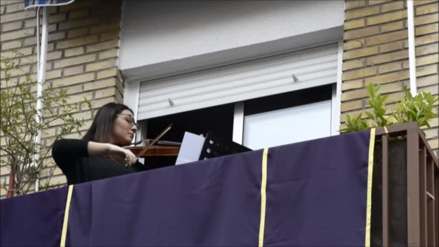 with a nationwide lockdown in place to curb the spread of covid-19, spaniards are finding ways to mark holy week from their homes, by playing music... - holy week stock videos & royalty-free footage