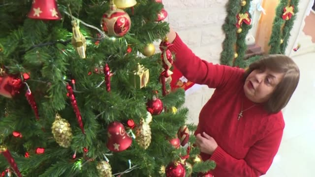 with a shining tree tinsel and santa miniatures hanadi missak's apartment is all ready for christmas yet she still feels sad about spending the... - tinsel stock videos & royalty-free footage