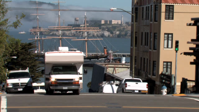 rv with alcatraz island in background - camper van stock videos & royalty-free footage
