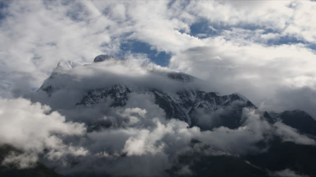 t/l with camera move, cloud over annapurna iii, himalayas - annapurna range stock videos and b-roll footage