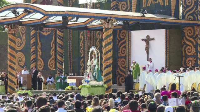 with chants in latin and guarani pope francis leads a huge open air mass sunday in asuncion with strong references to paraguayan culture hours before... - south american culture stock videos & royalty-free footage