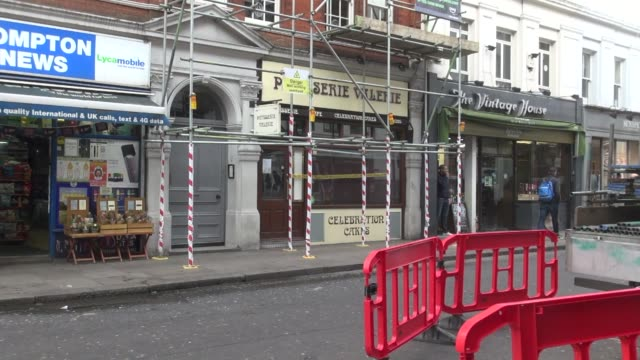 with 'crime scene' police tape across the front window people walking past and cyclists old compton street branch on 22 january 2019 the firm... - recession stock videos & royalty-free footage
