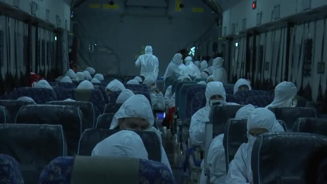 with dozens of evacuees aboard a military cargo plane of the turkish armed forces landed in turkey's capital ankara on saturday upon completing its... - corona stock-videos und b-roll-filmmaterial
