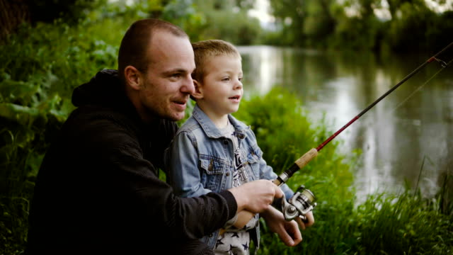 with father on fishing - spring flowing water stock videos & royalty-free footage