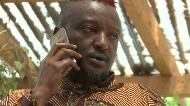 With hair dyed red and blue and shaved into a mohican leading Kenyan author Binyavanga Wainaina is no stranger to making a powerful statement CLEAN...