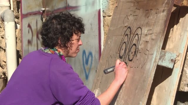 with her nose piercing jeans and sweatshirt rising street artist sara erenthal looks nothing like what she was 20 years ago a member of an extreme... - nose piercing stock videos & royalty-free footage