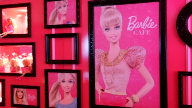 with hot pink sofas high heels shaped tables and chairs decorated with tutus the first barbie themed restaurant opens in taiwan catering to fans of... - doll stock videos & royalty-free footage