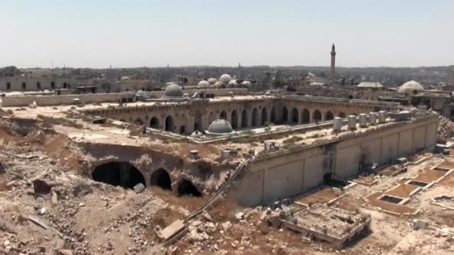With its battered facades pulverised houses and skeletons of buildings one of the world's oldest cities Aleppo which was recaptured by government...