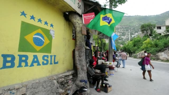 with just days to go before the world cup kicks off in brazil haiti has already caught a serious case of football fever flags from competing... - sportweltmeisterschaft stock-videos und b-roll-filmmaterial