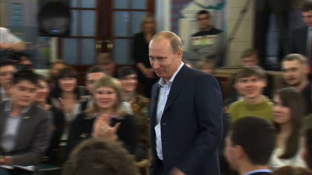 with just five weeks to go until russians head to the polls vladamir putin showed no signs of stress as he met with a group of students in siberia... - wladimir putin stock-videos und b-roll-filmmaterial