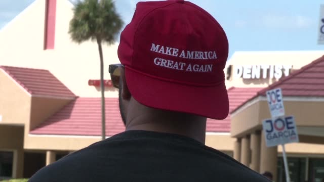 With just hours left until polls start to close Donald Trump supporters in Miami are still urging people to go out and vote