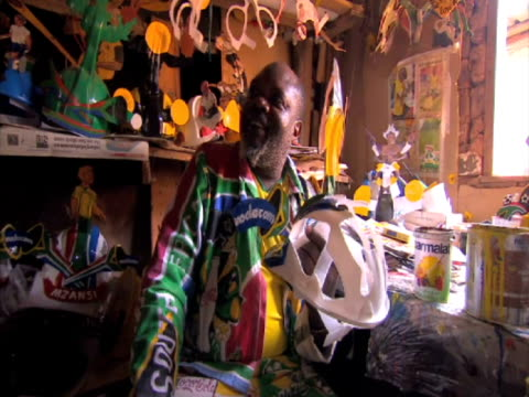 with just over a week to go until the world cup in south africa, the official merchandisers are being given a run for their money by one of the... - ハウテング州点の映像素材/bロール