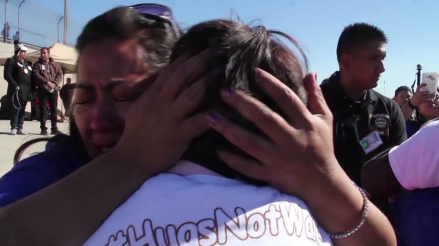 with long hugs hasty talks and tears mexican families separated by us deportations gathered on saturday for three minutes at a point on the rio... - deportation stock videos and b-roll footage