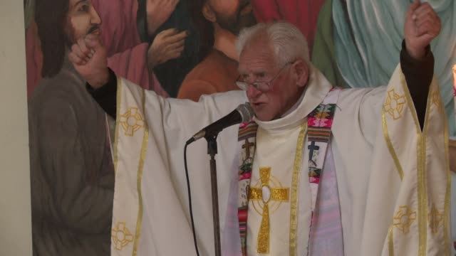 stockvideo's en b-roll-footage met with mass baptisms and a boost in weddings a catholic priest prepares residents of the bolivian city of el alto to welcome pope francis next july 27... - la paz bolivia
