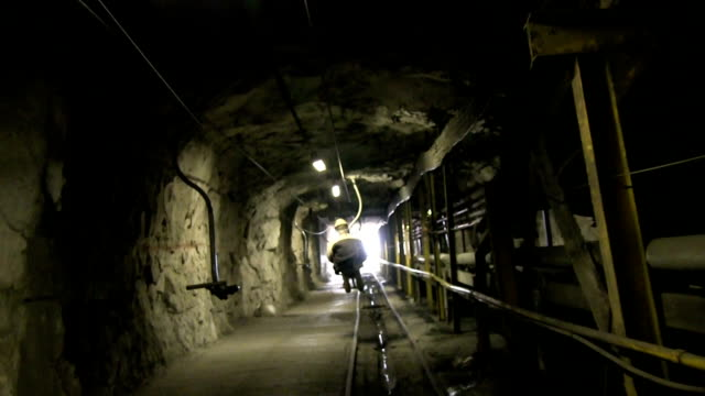 underground ski-lift with metal seats and conveyor  to the outside - miner stock videos & royalty-free footage