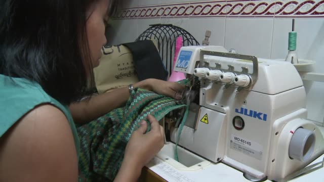 with myanmar emerging as a manufacturing hub for massproduced clothes a crop of young designers are using homegrown fashion to preserve the country's... - arbeitsintensive produktion stock-videos und b-roll-filmmaterial
