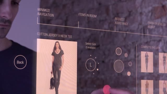 vídeos y material grabado en eventos de stock de with new york fashion week underway, a company is showing off what could be the fitting room of the future featuring an interactive mirror which... - interactividad