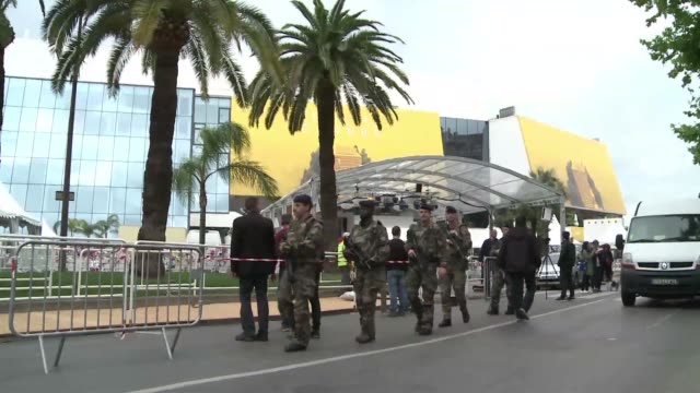 With one day to go until the Cannes Film Festival crews began installing the red carpet amid heightened security measures