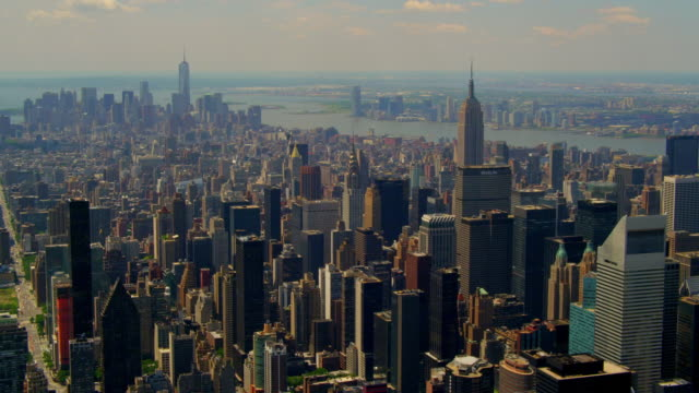 wide aerial pov with pan over midtown manhattan east looking toward downtown - citigroup center manhattan stock videos & royalty-free footage