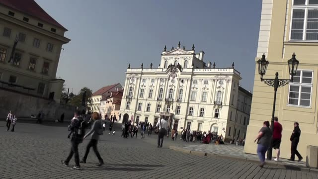 With people in square outside Prague Castle grounds