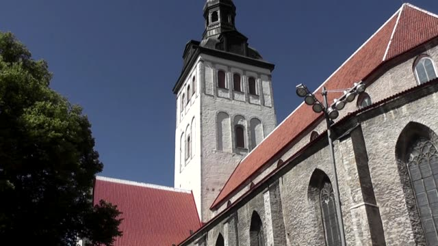 With people passing by across the square The former church today houses the Niguliste Museum one of the branches of the Art Museum of Estonia The...