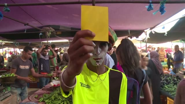 with punching bags for beating corruption and clowns to yellow card the system an independent tunisian anti party launches an unusual campaign to win... - yellow stock videos & royalty-free footage