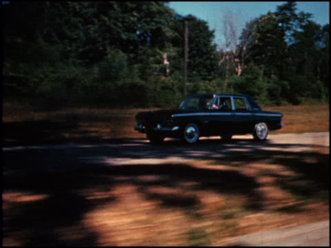 stockvideo's en b-roll-footage met / with quick editing showing fleeting closeups of the front end and different design features studebaker tries to convey excitement about the cruiser... - redacteur
