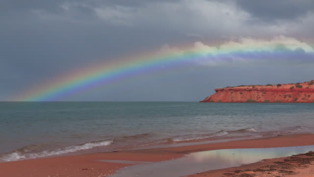WS with rainbow over sea and headland at Shark Bay